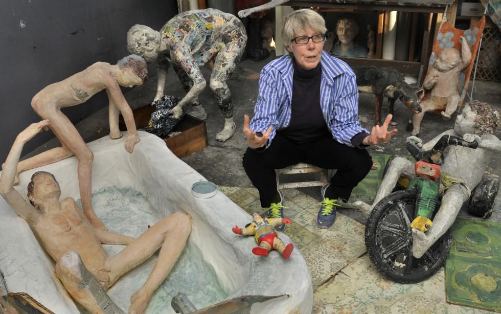 Harriet Diamond surrounded by her sculpture